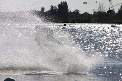 Wake Boarder Spray. A wake boarder being pulled by cable creates a giant plume of spray at Quiet Waters Park, Deerfield Beach, Florida Stock Photography