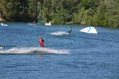 Wake-boarders and sky water  touch down after an jump at Cergy water amusement park, France Royalty Free Stock Photo
