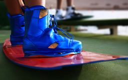 Wake boarding boots with wakeboard in blue color, water sports equipment, objects, sport. S royalty free stock photography