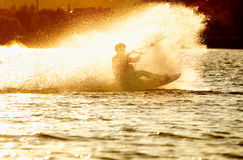 Wake- boarding on the lake Royalty Free Stock Photos