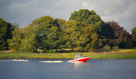 Wake-boarding on a lake behind a boat. In Ireland Royalty Free Stock Photo
