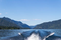 Wake from boat on Lake Teletskoye, Altai, Russia Royalty Free Stock Photography