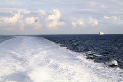 Wake of boat in sea Stock Photo