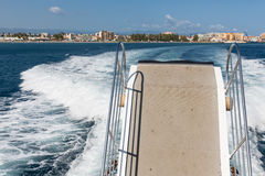 Wake and Gangway of ferry leaving harbor of Milazzo, Italy Stock Photo