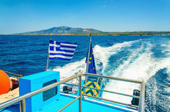 Wake from Greek speed boat and Greece flag Royalty Free Stock Image