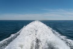 Wake of high speed ferry on blue sea Royalty Free Stock Photography