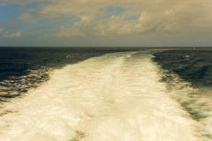 The wake of an inter-island ferry in the caribbean Royalty Free Stock Photo