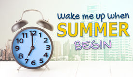 Wake me up when summer begin with blue alarm clock Royalty Free Stock Photography