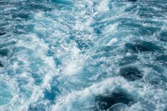 Wake in the Pacific Ocean. Full frame detail of a cruise ship wake in the Pacific Ocean in Fiji stock photo