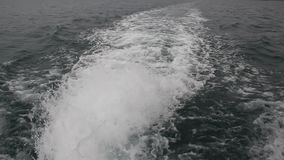 Wake of speed boat. Powerful waves pulled out from fast moving boat stock footage