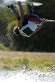 Wake Splash 01. A wake board competitor perfoms an aerial trick Royalty Free Stock Photography