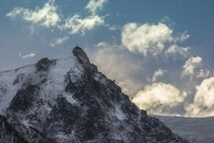 The wake of the summit. Sun hiding behind a summit, next to « Mont Blanc » in France Stock Images