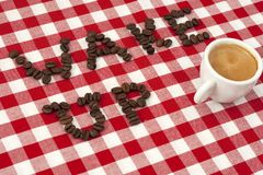 Wake up!. Wake up spelled with coffee beans with a cup of esspresso Stock Photos