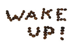 Wake up!. Phrase wake up written with coffee beans isolated on white royalty free stock photo
