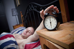 Wake up!. Man waking up in the morning royalty free stock photo