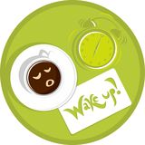 Wake up. Cup of coffee at six o'clock in the morning and a sticker that says wake up Royalty Free Stock Photography