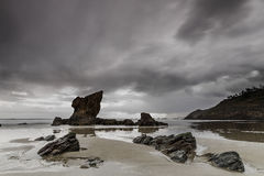 Wake Up Aguilar. The Aguilar beach in a winter rainy day at dawn Stock Images