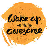 Wake up and awesome - calligraphic quote on a abstract background. Stock Photo