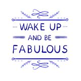 `Wake up and be fabulous` words with hand drawn calligraphic design elements. VECTOR handwritten letters. Blue lines. Stock Photos