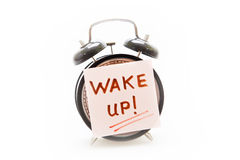 Wake up call concept with alarm clock and adhesive note Royalty Free Stock Image
