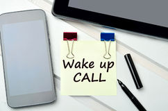 Wake up call words on notes. Wake up call words on yellow notes Stock Photos