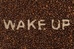 Wake up concept written on coffee beans Royalty Free Stock Images