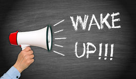 Wake up - female hand with megaphone. And text stock photography