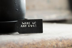 Wake up and live and a cup of coffee Royalty Free Stock Image