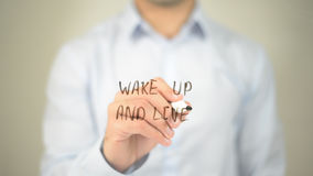 Wake Up And Live , man writing on transparent screen. High quality Royalty Free Stock Image
