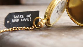 Wake up and live and pocket watch stock footage