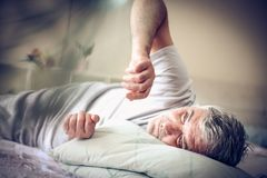 Wake up. Man in bed. stock photography