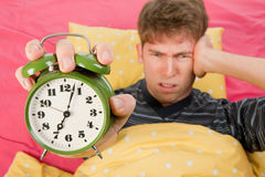 Wake up man with big alarm clock Stock Photo