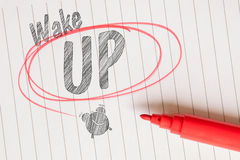 Wake up memo with a red brushed circle Royalty Free Stock Photo