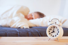 Wake up in the morning with alarm clock Stock Photography