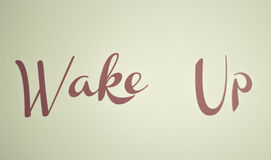 Wake up in red. Adhesive sign on the wall Royalty Free Stock Photography