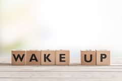Wake up sign with wooden cubes Stock Photo