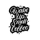 Wake up and smell the coffee hand written lettering with splashes. Stock Image