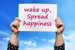 Wake up, Spread happiness. Motivational sign woman holding by hand royalty free stock images