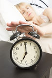 Wake Up Time: Middle Age Woman Reaching for Alarm Clock Royalty Free Stock Image