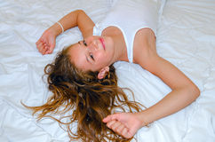 Wake up time. Young girl waking up (close up Stock Photo