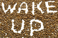 Wake up whith coffee. White inscription Wake Up made of coffee beans Royalty Free Stock Images