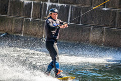 Wakeboard freestyle rider does tricks at competition. Taken at the Red bull Copen`n`Waken event in Frederiksholms Kanal, Copenhagen, Denmark. 17 June, 2017 royalty free stock image