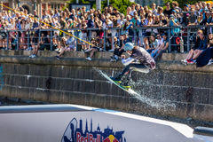 Wakeboard freestyle rider does tricks at competition. Taken at the Red bull Copen`n`Waken event in Frederiksholms Kanal, Copenhagen, Denmark. 17 June, 2017 Royalty Free Stock Images
