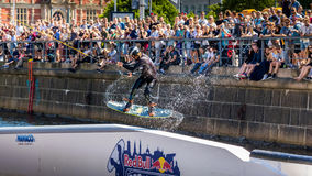 Wakeboard freestyle rider does tricks at competition. Taken at the Red bull Copen`n`Waken event in Frederiksholms Kanal, Copenhagen, Denmark. 17 June, 2017 stock photo