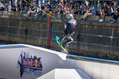 Wakeboard freestyle rider does tricks at competition. Taken at the Red bull Copen`n`Waken event in Frederiksholms Kanal, Copenhagen, Denmark. 17 June, 2017 Stock Images