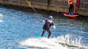 Wakeboard freestyle rider does tricks at competition Stock Images