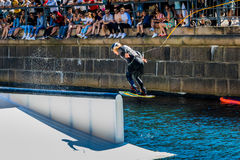 Wakeboard freestyle rider does tricks at competition Royalty Free Stock Photography