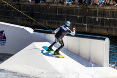 Wakeboard freestyle rider does tricks at competition Stock Photo