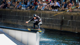 Wakeboard freestyle rider does tricks at competition Royalty Free Stock Photo