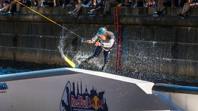 Wakeboard freestyle rider does tricks at competition Stock Image